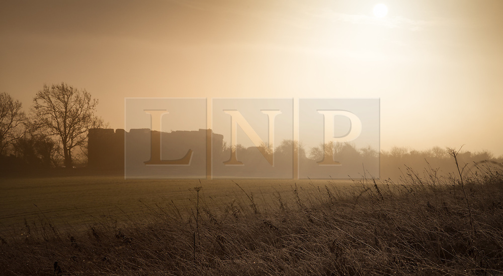 © Licensed to London News Pictures. 05/01/2014. Burghclere, Hampshire, UK. A misty sunrise over countryside near Burghclere in Hampshire. Photo credit : Rob Arnold/LNP