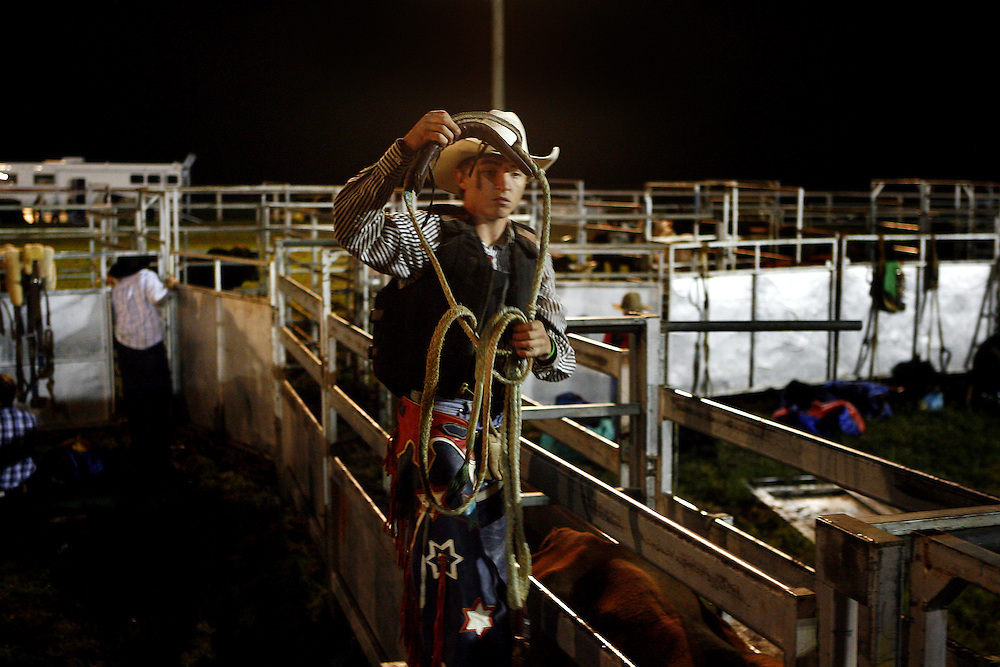 A Young bullrider prepares for his ride during a competition at Casino showground during the annual Beef Week celebrations. Casino is a Cattle town in northern NSW, Australia.