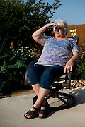 Debbie Ingram poses for a photograph in her backyard on July 22, 2014 in Argyle, Texas. Just a few hundred feet over the hill is a gas well that was last fracked in March. (Cooper Neill for The Texas Tribune)