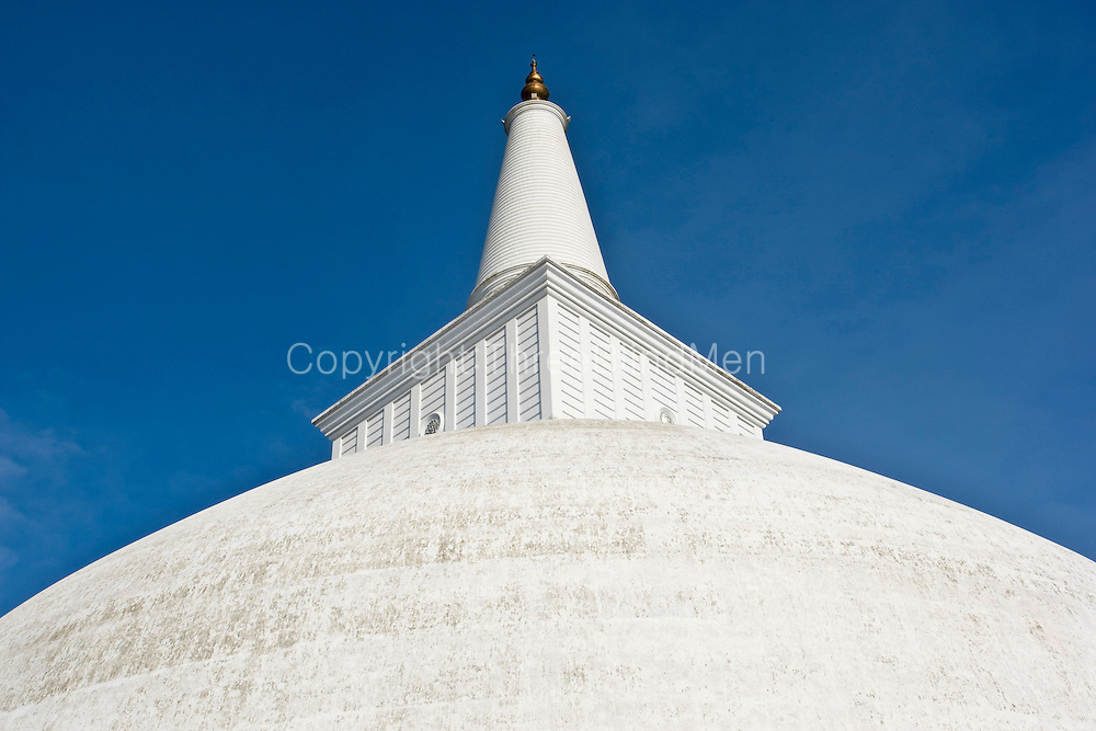 Ruwanweliseya Stupa. Anuradhapura is one of the ancient capitals of Sri Lanka, famous for its well-preserved ruins of ancient Lankan civilization.<br /> <br /> The city, now a UNESCO World Heritage Site, lies 205 km north of the current capital Colombo in Sri Lanka's North Central Province, on the banks of the historic Malvathu Oya.