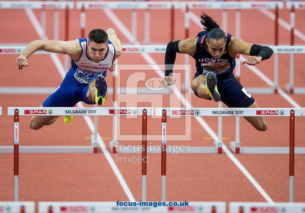 Andy Pozzi of Great Britain and Pascal Martinot-Lagarde of France compete during the 60m Hurdles Men Final  on day one of the 34th European Indoor Athletics Championships Belgrade 2017 at the Kombank Arena, Belgrade<br /> Picture by EXPA Pictures/Focus Images Ltd 07814482222<br /> 03/03/2017<br /> *** UK &amp; IRELAND ONLY ***<br /> <br /> EXPA-SLO-170303-0010.jpg