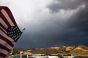 United States flag and rainbow, Gardiner, Montana, the north west gateway town to Yellowstone National Park.