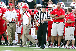 10 September 2011: Brock Spack (far left) looks down the sidelines during an NCAA football game between the Morehead State Eagles and the Illinois State Redbirds at Hancock Stadium in Normal Illinois.