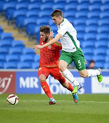 Wes Burns of Wales u21s (Bristol City) battles for the ball with Plamen Galabov of  Bulgaria  - Photo mandatory by-line: Alex James/JMP - Mobile: 07966 386802 - 31/03/2015 - SPORT - Football - Cardiff - Cardiff City Stadium - Wales v Bulgaria - U21s International Friendly