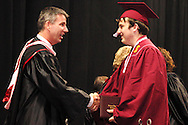 Principal Scott Butler (left) greets the new graduates during the 142nd annual Lebanon High School commencement at the Nutter Center in Fairborn, Saturday, May 26, 2012.