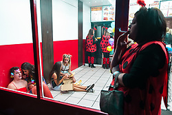 © Licensed to London News Pictures . 27/12/2017. Wigan, UK. People sit on the floor of a takeaway . Revellers in Wigan enjoy Boxing Day drinks and clubbing in Wigan Wallgate . In recent years a tradition has been established in which people go out wearing fancy-dress costumes on Boxing Day night . Photo credit: Joel Goodman/LNP