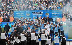 © Licensed to London News Pictures. London, UK. 11/05/2014. London, UK.  Manchester City FC celebrates after  winning the Barclays Premier League  at the Etihad Stadium.Photo credit: LNP