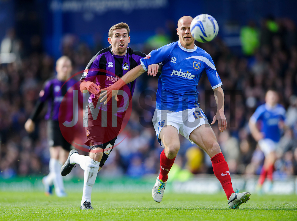 Steven Gillespie (ENG) of Bristol Rovers challenges Johannes Ertl (AUT) of Portsmouth - Photo mandatory by-line: Rogan Thomson/JMP - 07966 386802 - 19/04/2014 - SPORT - FOOTBALL - Fratton Park, Portsmouth - Portsmouth FC v Bristol Rovers - Sky Bet Football League 2.