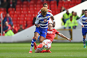 Nottingham Forest midfielder David Vaughan (24) fouls Reading midfielder Daniel Williams (23) during the EFL Sky Bet Championship match between Nottingham Forest and Reading at the City Ground, Nottingham, England on 22 April 2017. Photo by Jon Hobley.