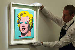 "© Licensed to London News Pictures. 08/04/2016. London, UK. A Sotheby's technician carries Elaine Sturtevant's ""Warhol's Marilyn Monroe"", 1967, est. $0.3-0.4million at Sotheby's auction preview, at their New Bond Street gallery, of works to be in the upcoming New York Impressionist, modern and contemporary art sale. Photo credit : Stephen Chung/LNP"