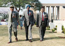 © Licensed to London News Pictures. 11/11/2012. Delhi, India. Indian veterans of the World Wars walk past gravestones at Delhi War Cemetery, India, where a Remembrance Day ceremony was held today.  Remembrance Day (also known as Poppy Day or Armistice Day) is a memorial day observed in Commonwealth countries since the end of World War I to remember the members of their armed forces who have died in the line of duty. This day, or alternative dates, are also recognized as special days for war remembrances in many non-Commonwealth countries. Remembrance Day is observed on 11 November to recall the end of hostilities of World War I on that date in 1918.   Photo credit : Richard Isaac/LNP