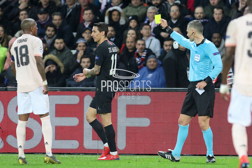 Referee Damir Skomina of Slovenia shows a yellow card to Angel Di Maria of Paris Saint-Germain during the Champions League Round of 16 2nd leg match between Paris Saint-Germain and Manchester United at Parc des Princes, Paris, France on 6 March 2019.