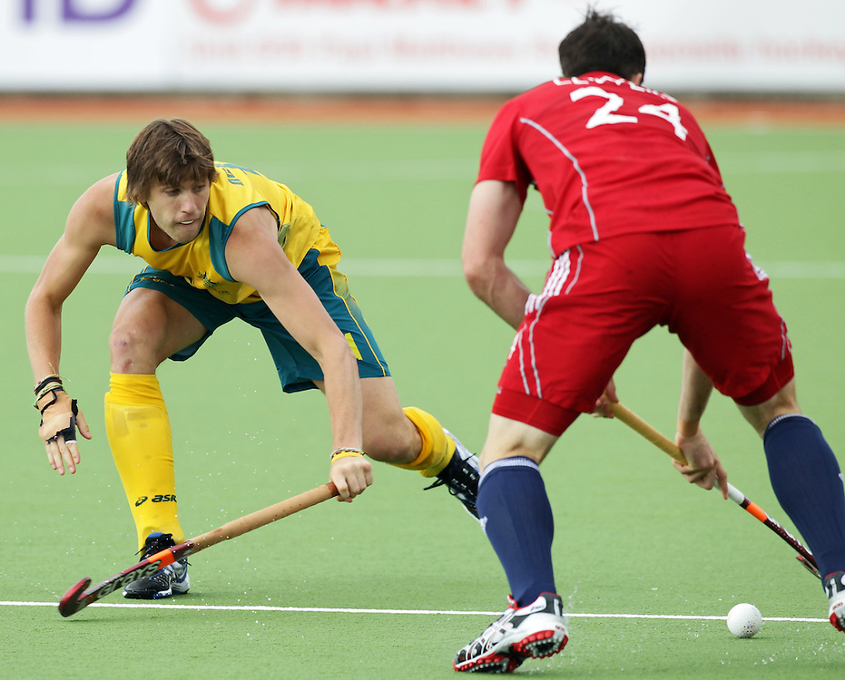 Australia's Edward Ockenden challenges Great Britain's Iain Lewers in a pool A match of the Hockey Champions Trophy, Auckland, New Zealand, Monday, December 05, 2011.  Credit:SNPA / David Rowland