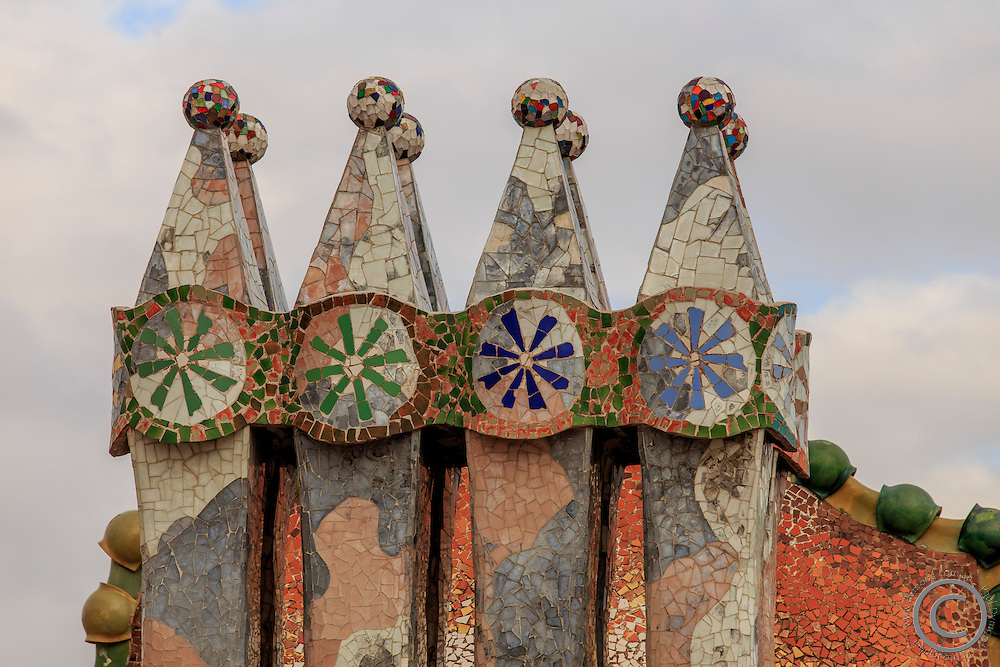 Unusual chimneys on the roof of Casa Battlo in downtown Barcelona, Spain, one of Antonio Gaudi's most famous buildings.