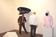 LUIS RUIZ STANDING UNDER CAP, Opening of Miami Art Basel 2011, Miami Beach. 30 November 2011.