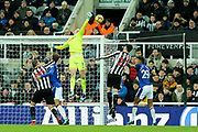 Jordan Pickford (#1) of Everton pushes the ball away from the head of Mikel Merino (#23) of Newcastle United during the Premier League match between Newcastle United and Everton at St. James's Park, Newcastle, England on 13 December 2017. Photo by Craig Doyle.