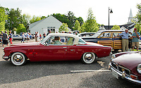 Richard Langworth backs in his 1953 Studebaker Starliner at the Gilford Community Center for Cruise Night on Thursday evening.  (Karen Bobotas/for the Laconia Daily Sun)