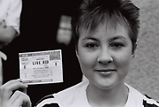 Woman holding her ticket to Live Aid, Southall, UK, 1985