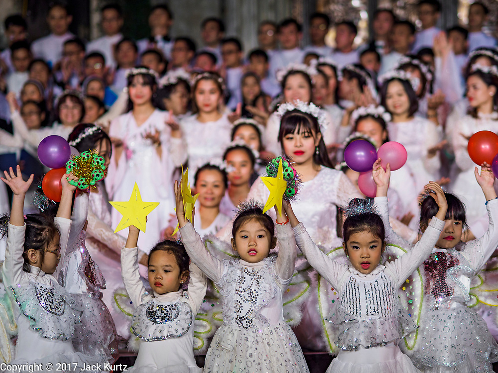 22 DECEMBER 2017 - HANOI, VIETNAM: The opening number during the Christmas show at St. Joseph's Cathedral in Hanoi. There are about 5.6 million Catholics in Vietnam. The Cathedral was one of the first structures built by the French during the colonial era and was opened in 1886. It's one of the most popular tourist attractions in Hanoi.     PHOTO BY JACK KURTZ