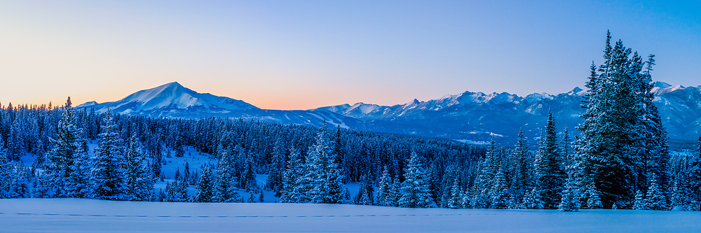 Snow covered trees, the Spanish Peaks and Lone Peak at dusk.  Limited Edition - 75