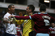 Jermaine Beckford of Preston and Matthew Lowton of Burnley are separated by Tom Heaton of Burnley during the Sky Bet Championship match between Preston North End and Burnley at Deepdale, Preston, England on 22 April 2016. Photo by Simon Brady.