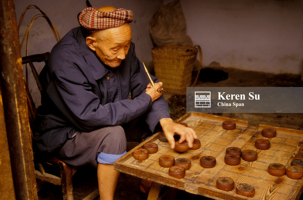 An old man playing Chinese chess (MR), Dachang, Sichuan Province, Three Gorges, Yangtze River, China