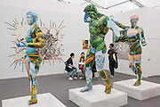 New York, NY - 6 May 2016. Frieze New York art fair. Three oversized sculptures in concrete, marble grains, and other materials depicting Marathon Boy, Marsyas and Hertcules by Xu Zhen, a Chinese artist working in Shanghai, in ShanghART.