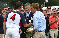 HRH PRINCE HARRY presents the Coronation Cup to LUKE TOMLINSON watched by ARNAUD BAMBERGER at the Cartier International polo at Guards Polo Club, Windsor Great Park, on 30th July 2006.<br /><br />NON EXCLUSIVE - WORLD RIGHTS