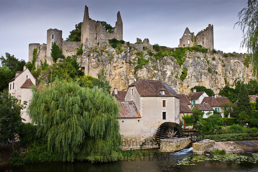 Traditional French houses and Chateau Guichard ruins at Angles Sur L'Anglin medieval village, Vienne, near Poitiers, France