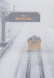 © Licensed to London News Pictures. 27/02/2018. New Hythe, UK.  A fire engine travels on an empty stretch of the M20 as snow falls. Freezing temperatures and heavy snow are affecting large parts of Kent.  Photo credit: Peter Macdiarmid/LNP