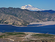 Hiking the trails at Mount St. Helens offers views of other Cascade volcanoes, including Mount Rainier with Spirit Lake in front. (MIke Siegel / The Seattle Times)