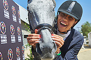 SO Poland athlete Marta Borowska with horse called Sinatra pose to picture while equestrian competition during eighth day of the Special Olympics World Games Los Angeles 2015 on August 1, 2015 at Equestrian Centre Riverside Drive Burbank in Los Angeles, USA.<br /> USA, Los Angeles, August 1, 2015<br /> <br /> Picture also available in RAW (NEF) or TIFF format on special request.<br /> <br /> For editorial use only. Any commercial or promotional use requires permission.<br /> <br /> Adam Nurkiewicz declares that he has no rights to the image of people at the photographs of his authorship.<br /> <br /> Mandatory credit:<br /> Photo by &copy; Adam Nurkiewicz / Mediasport