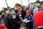AFC Bournemouth defender Simon Francis signing autographs outside the Vitality Stadium before The FA Cup match between Bournemouth and Everton at the Goldsands Stadium, Bournemouth, England on 20 February 2016. Photo by Graham Hunt.