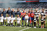 Photo by Andrew Tobin/Tobinators Ltd 26th May 2013 England line up with mascots and ball carrier with referee Nigel Owens before the England v Barbarians match at Twickenham, London.