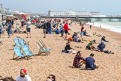 © Licensed to London News Pictures. 24/05/2020. Brighton, UK. Members of the public take to the beach in Brighton and Hove own the May Bank Holiday Sunday. Photo credit: Hugo Michiels/LNP