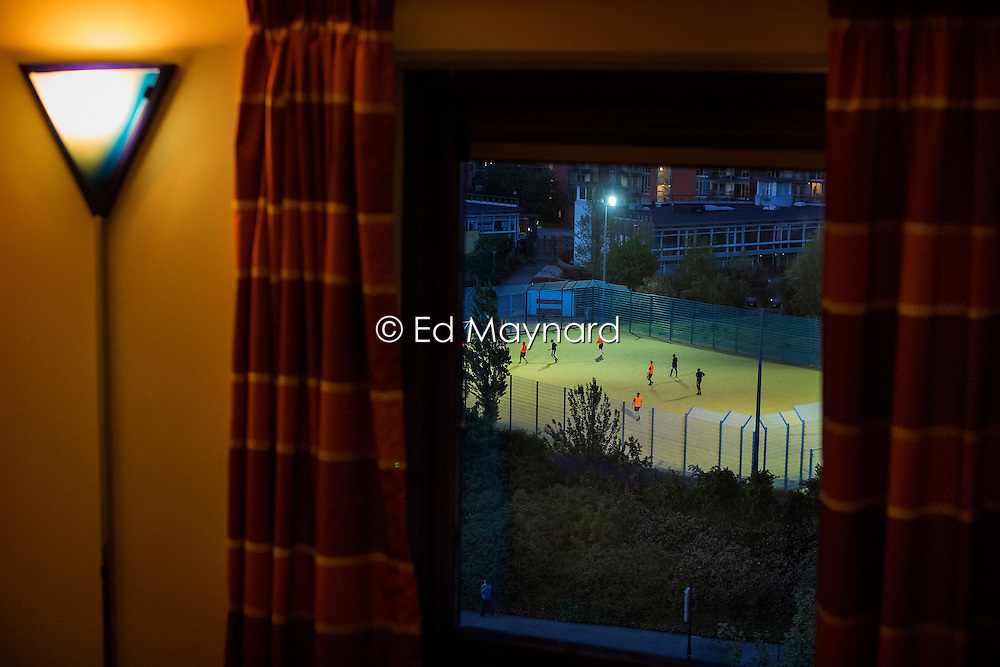 Floodlit community football and sports pitches viewed from a room at the Holiday Inn, Greenwich, London, England, UK.