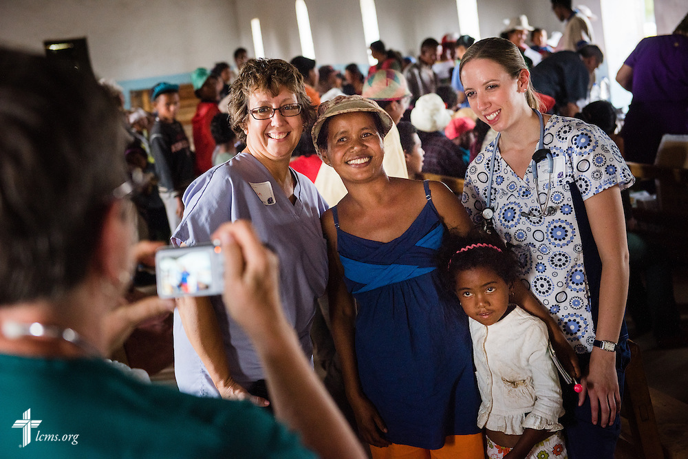 Miriam Wilson and Molly Christiansen (right) pose for a picture with visitors to the Mercy Medical Team during a clinic on Saturday, Oct. 18, 2014, at a Fiangonana Loterana Malagasy (FLM) Lutheran church in Antsoantany, Madagascar. LCMS Communications/Erik M. Lunsford