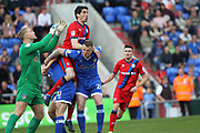 Peter Vincenti climbs on Peter Clarke during the EFL Sky Bet League 1 match between Oldham Athletic and Rochdale at Boundary Park, Oldham, England on 22 April 2017. Photo by Daniel Youngs.