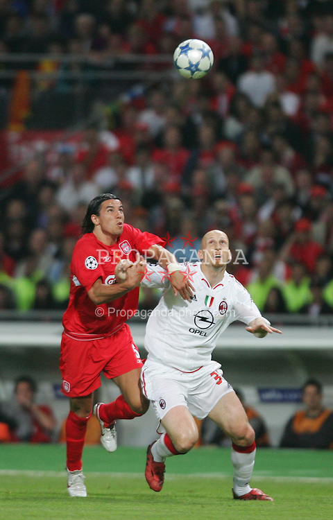 ISTANBUL, TURKEY - WEDNESDAY, MAY 25th, 2005: Liverpool's Milan Baros and AC Milan's Jaap Stam during the UEFA Champions League Final at the Ataturk Olympic Stadium, Istanbul. (Pic by David Rawcliffe/Propaganda)