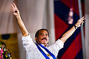 "10 JANUARY 2007 - MANAGUA, NICARAGUA:  DANIEL ORTEGA, newly inaugurated president of Nicaragua, waves to the crowd during his inaugural speech. Ortega, the leader of the Sandanista Front, was sworn in as the President of Nicaragua Wednesday. Ortega and the Sandanistas ruled Nicaragua from their victory of ""Tacho"" Somoza in 1979 until their defeat by Violetta Chamorro in the 1990 election.  Photo by Jack Kurtz"