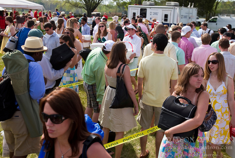 Students line up to pass security checks as new rules governing the consumption of alcohol were enforced at the Foxfield Races.  The 2009 Foxfield Races were held at the Foxfield Race Course in Charlottesville, VA on April 25, 2009. (Special to the Daily Progress / Jason O. Watson)