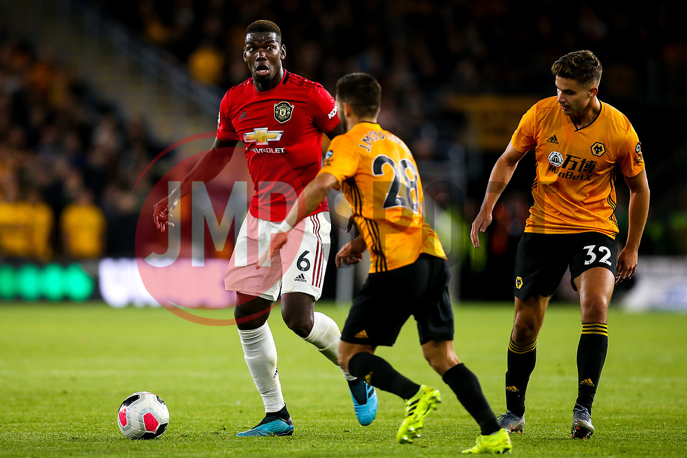 Paul Pogba of Manchester United takes on Joao Moutinho of Wolverhampton Wanderers - Mandatory by-line: Robbie Stephenson/JMP - 19/08/2019 - FOOTBALL - Molineux - Wolverhampton, England - Wolverhampton Wanderers v Manchester United - Premier League