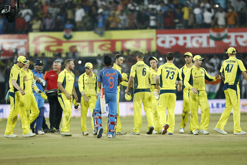Australia Players and shake hands with Mahendra Singh Dhoni of India and Manish Pandey of India after the 3rd One Day International between India and Australia held at the Holkar Stadium in Indore on the 24th  September 2017<br /> <br /> Photo by Arjun Singh / BCCI / SPORTZPICS