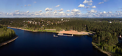 Verevi lake in Elva, Estonia. Beach, forest. Aerial view. Wooden boardwalk.