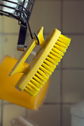 yellow hand brush hanging