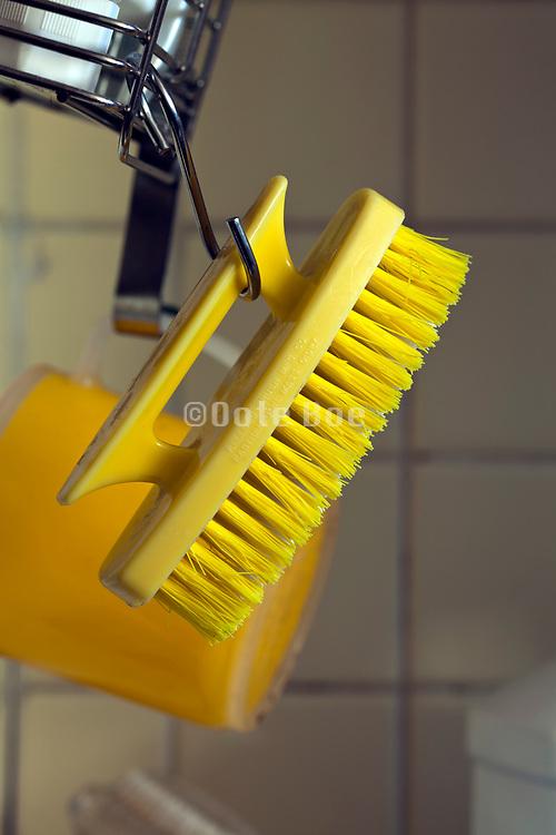 yellow hand brush hanging