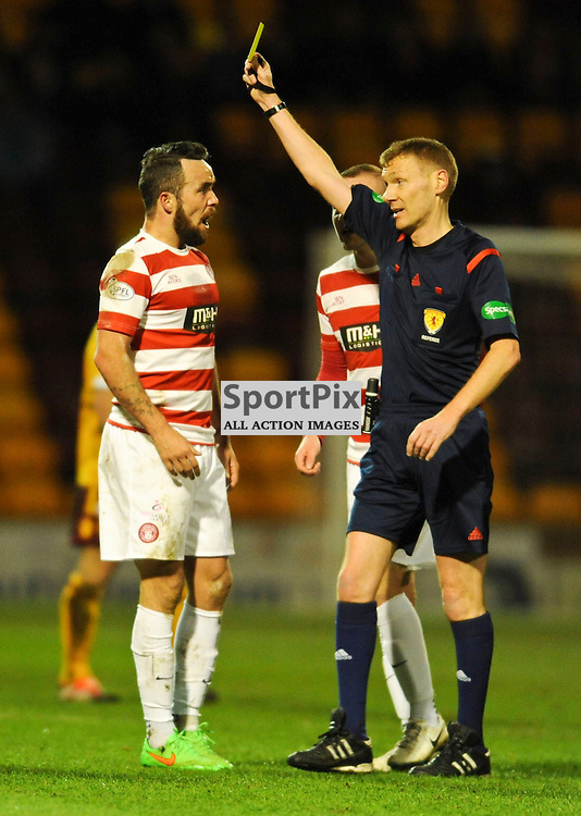 Dougie Imrie is booked for a foul on Keith Lasley<br /> .....(c) Angie Isac | SportPix.org.uk