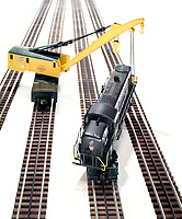 Train and crane toys on white background