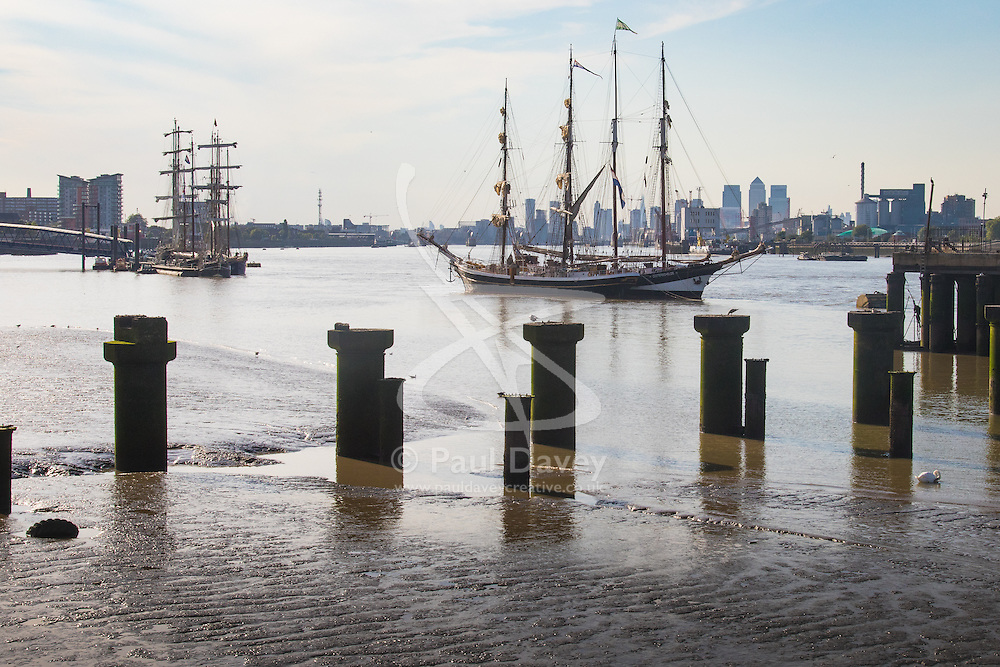 Woolwich, London, September 14th 2016. The afternoon suns illuminates the skyscrapers of Docklands and the Tall ships gathered for the Sail Greenwich Festival 2016 on the River Thames at Woolwich.  ©Paul Davey<br /> FOR LICENCING CONTACT: Paul Davey +44 (0) 7966 016 296 paul@pauldaveycreative.co.uk