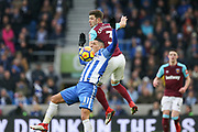 Brighton and Hove Albion midfielder Anthony Knockaert (11) battles in the air with West Ham United defender Aaron Cresswell (3) during the Premier League match between Brighton and Hove Albion and West Ham United at the American Express Community Stadium, Brighton and Hove, England on 3 February 2018. Picture by Phil Duncan.
